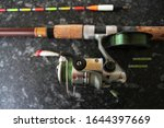Small photo of fishing equipment for fishing, spinning with a reel, fishing line, float and wobbler.