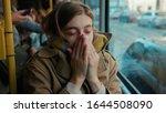 sick young woman coughs sneezes ... | Shutterstock . vector #1644508090