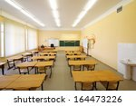 empty classroom with wooden... | Shutterstock . vector #164473226