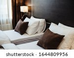 Small photo of Closeup bed of beautiful bedding in modern bedroom interior. Clean white pillows on the bed in the hotel room. Modern hotel room with twin beds. Hotel double room. Film noise.
