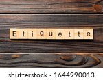 Small photo of ETIQUETTE word written on wood block. ETIQUETTE text on wooden table for your desing, concept.