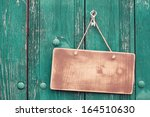 wooden signboard with rope... | Shutterstock . vector #164510630