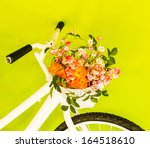 White Bicycle With Flower On...
