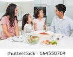 smiling family of four sitting... | Shutterstock . vector #164550704