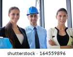 group of happy young  business... | Shutterstock . vector #164559896