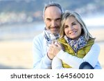 senior couple sitting by the... | Shutterstock . vector #164560010