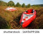 Red Inflatable Kayak On The...