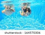 Happy Girls Swim Underwater In...