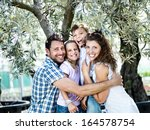 Happy Family Embracing Under A...