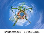 Industry concept with planet on blue sky. - stock photo