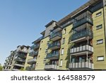 building exterior on a sunny day | Shutterstock . vector #164588579