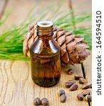 cedar oil in a bottle  cone and ... | Shutterstock . vector #164594510