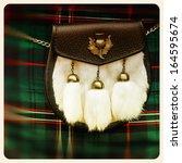 Small photo of Traditional Scottish sporran over tartan background. Retro style photo.
