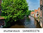 Tourist Boat In Canal Between...
