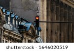 Small photo of Bucharest, Romania - October 10, 2018: A red traffic light is seen on the background of old and degraded historic buildings in downtown Bucharest