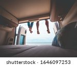 couple in a camper van on the beach - stock photo