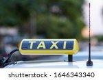 Taxi Sign On Top Of A Greek Cab ...