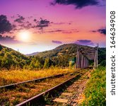 morning mountains landscape. rail metal bridge - stock photo
