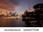 silhouette of an offshore oil... | Shutterstock . vector #164657558