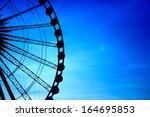 Silhouette Of Giant Ferris...