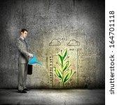 image of businessman watering... | Shutterstock . vector #164701118