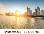 cityscape with sunset | Shutterstock . vector #164706788