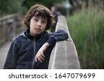 Portrait Of A Sad Boy Near A...