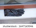 Old Black Leather Gloves Lie On ...