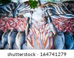 fresh fish on the counter at a... | Shutterstock . vector #164741279