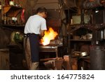 a blacksmith heating metal in... | Shutterstock . vector #164775824