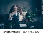 Small photo of Smart cool dandy old retired man ceo grandfather grey white hair grandfather sit chair relax rest working day read retro start-up magazine smoke cigar in modern workplace workstation