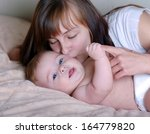 portrait of mother kissing her... | Shutterstock . vector #164779820