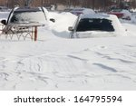 cars covered in snow after a... | Shutterstock . vector #164795594