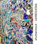 on the wall a mosaic of broken... | Shutterstock . vector #1648016566