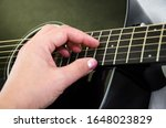 Hand Plays The Black Guitar....