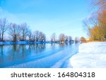 Winter River And Trees In...