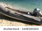 A Dinghy Boat Parked On The...