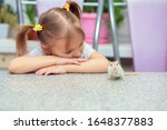 Little Cute Girl Plays At A...