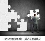 image of businessman compiling... | Shutterstock . vector #164850860