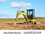 Mini Excavator Digging Earth In ...