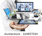 technology in the hands of... | Shutterstock . vector #164857034