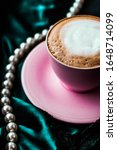 Small photo of Menu, branding and recipe concept - Cup of cappuccino for breakfast with satin and pearls jewellery background, organic coffee with lactose free milk in parisian cafe for luxury vintage holiday brand