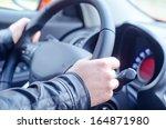 man driving his car | Shutterstock . vector #164871980