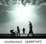 Silhouette Of Mother Pushing...