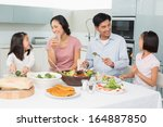Young Family Of Four Enjoying...