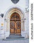 Small photo of Tallinn / Estonia: February 06 2020: Sublime carved wood door on Suur-Karja street in Tallinn Old Town, the building that hosts Polish embassy and was build for the bank.