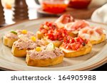 bruschette with tomatoes  tuna... | Shutterstock . vector #164905988