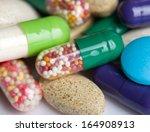 pills isolated on white... | Shutterstock . vector #164908913