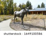 Grand Teton National Park, USA / September 21, 2018: Named for Grand Teton, the tallest mountain in the Teton Range. Bronze elk statue at the front of the visitor center. - stock photo