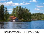Still Blue Lake With Rural Home ...